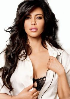 Kim Kardashian. She may be crazy and stupid sometimes....but she is beautiful and I admire her style!
