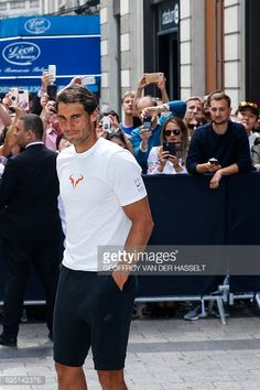 Spain's Rafael Nadal attends a promotional event at the Nike Store on the Champs-Elysees avenue on June 12, 2017 in Paris, a day after he won the men's Roland Garros 2017 French Open. / AFP PHOTO / GEOFFROY VAN DER HASSELT (Photo credit should read GEOFFROY VAN DER HASSELT/AFP/Getty Images)
