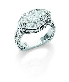 East-West marquise cut diamond halo ring ~ Mark Lash Jewelers