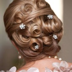 Sophisticated updo for a mother of the bride