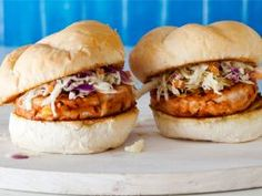 BBQ Chicken Burgers with Slaw : Rachael makes a thick, concentrated barbecue sauce to mix into these chicken burgers. The slaw topping is mayonnaise-free — made instead with lemon juice and honey — all ready for a summer cookout.