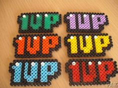 1UP Fridge Magnets and Brooches/Badges.Nintendo Super Mario Brothers World Hama