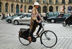 Catherine Baba-so cool on her bike, and look at the pannier bags!