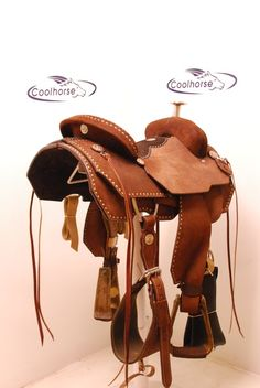 Double J roping saddle with rawhide buckstitching and pistol conchos