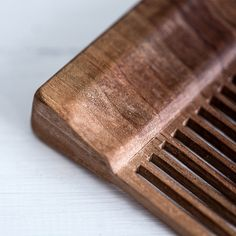 The Timberwolf Beard Comb. Hand made from a solid piece of Black Walnut. Hand sanded, filed and finished into a beautiful pocket sized accessory.