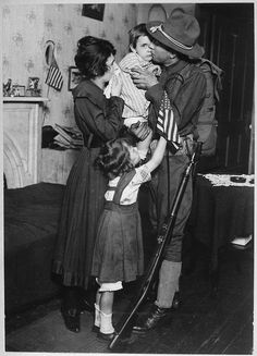 Private T. P. Loughlin of the 69th Regiment, New York National Guard, (165th Infantry) bidding his family farewell/1917
