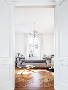 A glimpse at the apartment of furniture/art collectorDemetrio Zanetti & Veruska Gennari ... love all the eclectic pieces used throughout & the gorgeous wood floors.photos by christian...