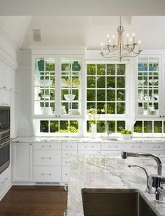 3. Picture-window cabinets. What do you do when you have a kitchen that has more windows than wall space? Try putting your wall cabinets directly over the windows, like in this photo.