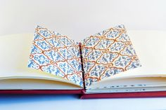 Red book binding inside by RUaDSarah, via Flickr.
