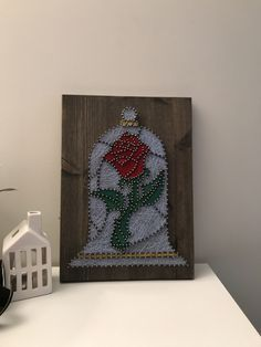 String art of Disney's beauty and the beast rose