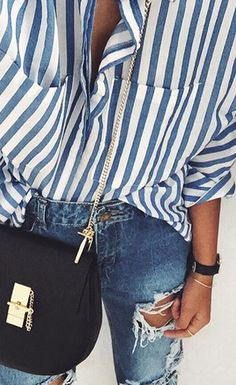 Oversized shirts are all about simplicity. Add denim shorts or denim jeans and simple accessories in one colour and you can't lose. Love the blue and white stripe. See more of what we love at https://www.pinterest.com/stolenfrmmysis #stripes #shirt #oversizedshirt