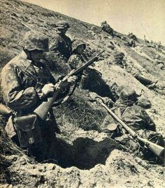 SS soldier examining a French Berthier Carbine