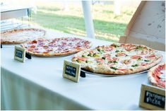 A gourmet pizza bar at your reception is easy on the budget and fun, too! Who wouldn't love specialty pizza?  Hill City Bride - Elizabeth Henson #pizza #wedding #budget
