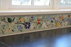 Something like this with a Deruta or Mexican color scheme? We created this colorful floral mosaic border for our Florida client's kitchen. It is high and 10 feet long. The floral mosaic is all hand-cut glass tiles set to a tile backerboard. The borde. Kitchen Mosaic, Mosaic Backsplash, Mosaic Wall, Mosaic Glass, Mosaic Tiles, Stained Glass, Glass Art, Glass Tiles, Glass Kitchen