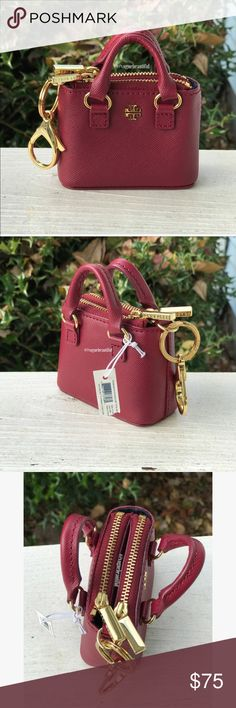 """NWT Tory Burch Robinson Double Zip Tote Key Fob ✨Perfect gift for the holidays! ✨Brand new with tags still attached 100% authentic Tory Burch Robinson Double Zip Tote key fob in a deep red/burgundy • Perfect to clip onto keys or onto your purse! • made of saffiano leather • color may vary slightly from photos taken in daylight • DIMENSIONS:  3 & 1/2"""" x 2 & 3/4"""" x 1 & 1/2"""" (approximate) • Gold tone hardware • ‼️NO TRADES‼️ Tory Burch Accessories Key & Card Holders"""