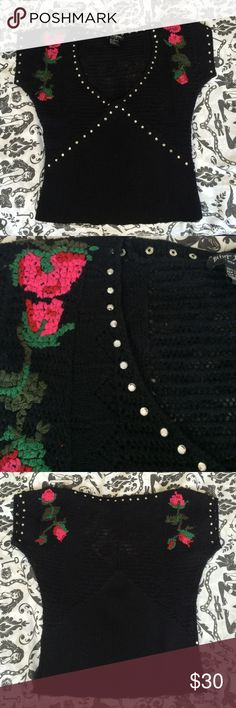 Betsey Johnson sweater Adorable Betsey Johnson sweater with flowers and rhinestones. 100% lambs wool. Worn and shows some pilling but still in good condition and definitely looks great on. Top part is very sexy with a wider knit so you can see through (see last photo). Betsey Johnson Tops