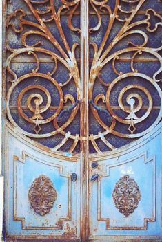 Old Rusty Blue and Gold Door in Alpiarca, Santarem, Portugal - Photo by Filipa - https://www.flickr.com/photos/lobo_filipa/6123380986/in/album-72157629527639865/