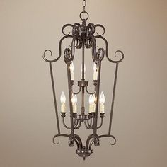 This nine-light bronze chandelier was inspired by French Renaissance architecture and furnishings, and is an ideal look for a foyer or entryway.