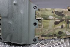 Ares Armor is showing off its new Kydex Full Spectrum MOLLE holster, a rig that requires no hardware to mount to any MOLLE panel. Tactical Survival, Tactical Gear, Survival Gear, Holsters, Tac Light, Battle Belt, Ghillie Suit, Titanium Metal, Knives