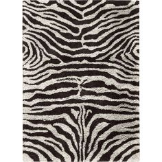 Bring eye-catching appeal to your master suite or guest room with this tufted rug, showcasing a zebra stripe design for exotic appeal.