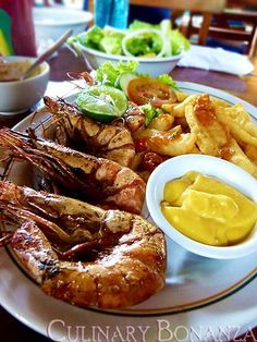 BBQ Giant Prawn lunch- Yuuuuuummmm Grilled prawns, deep yellow ( possible saffron infused ) mayonnaise and crispy chips. I just died and went to heaven, and put on a couple of pounds just looking at this picture--