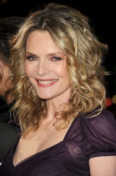 Michelle Pfeiffer Long Curls - Michelle Pfeiffer wore her hair in a bouncy mass of soft curls at the premiere of 'New Year's Eve.'