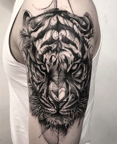 cool blackwork tiger tattoo by @bk_tattooer