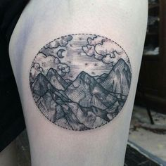 Mountain and clouds, within a circle tattoo …