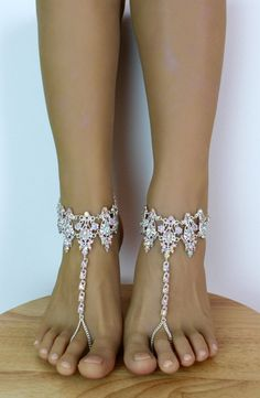 Amira Barefoot Sandals are absolutely breathtaking. These gorgeous barefoot sandals sit comfortably on your foot and shine like diamonds. Handcrafted using silver hues, an abundance of rhinestones and silver plated chain. The photos truly do not do the sandals any justice. Super easy to put on and take off: the sandals feature an adjustable closure on the back and 2 inches of chain for flexible