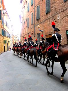 ~Palio. Siena. Carabinieri Tuscany~   The Palio di Siena is a horse race that is held twice each year, on July 2 and August 16, in Siena, Italy. Ten horses and riders, bareback and dressed in the approp…