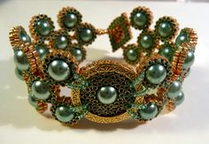 """Kathy King  (www.kathykingjewelry.com) - """"Coastal Queen Bracelet"""" - She combines her own weaving techniques with traditional bead weaving to develop one-of-a-kind pieces."""