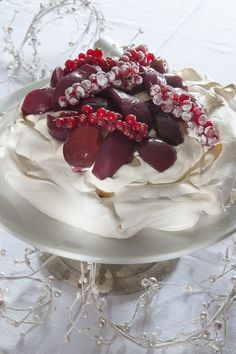 Noel Pavlova with Brandy Cream, Mulled Pears and Plums