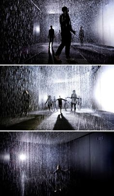 "Devised by UK-based rAndom International, the ""Rain Room"" allows visitors to pass through a downpour without getting wet. The installation is set on a darkened stage solely lit by one large spotlight. Cameras map human movement in the 100-square-meter room and send instructions for the rain to move near people, yet not too near, as they traverse the space."