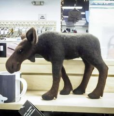 Whoa! Look at this needle felted moose one of our customers made. That's incredible.
