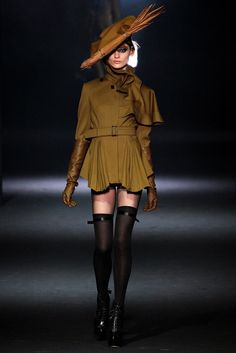 8. John Galliano Fall 2012 RTW; The hat is a modern take on the German hat  and the ruffles around the neck are an interpretation of the ruffs on the collars of both men and women during the Northern Renaissance.