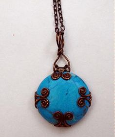 turquoise pendant set in natural brass