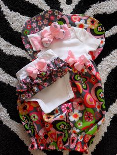 Baby Shower Gift Custom Onesie Layette Set Sleep Sack, Ruffle Bloomers, Burp Cloth, Lace Headband, Matching Hairbow Newborn 0/3M or 3/6M. $39.99, via Etsy.