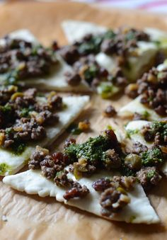 This empanada flatbread recipe is made of white sweet potato, making it paleo, and AIP-friendly. Serve topped with piccadillo filling and chimichurri sauce.