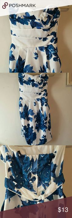 Stunning Formal Mini This dress is so pretty. The blue flowers are so bright. Strapless with a zip up back. Sash ties in back. The front is pleated and it has pockets.  Size 5  100% polyester  Absolutley gorgeous.  Snag and stain free  In new condition. Teeze Me Dresses Prom