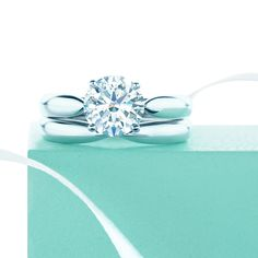 So happy together. Tiffany Harmony® diamond engagement ring with a matching wedding band.