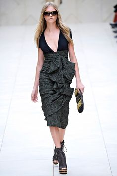 Loving the silhouette of this Burberry Prorsum SS12 dress for Oaks...neutral colours would bring out the femininity in it even more.