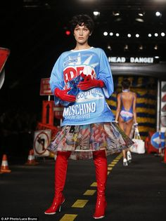 Beyond Warhol's Campbell soup can: Bella Hadid wore a Windex-themed outfit on the runway of the outrageous Moschino spring/summer 2016 show in Italy on Thursday