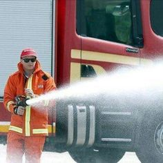 Kimi as firefighter at the Malaysian GP!