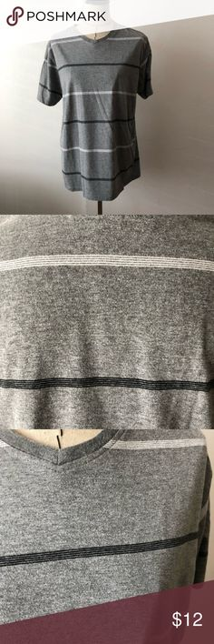 Men's grey striped v neck t shirt Great condition but it looks like it is the start of piling - not too noticeable from far away in my opinion Grey v neck with black and white stripes 70% cotton, 30% polyester Shirts Tees - Short Sleeve