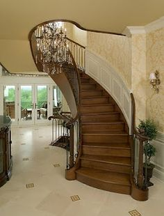 Stairs - Circular Stairs do not have a central pole and there is a handrail on both sides. These have the advantage of a more uniform tread width when compared to the spiral staircase. Like this?  Check out our website www.visbeen.biz and facebook page www.facebook.com/visbeenassociates