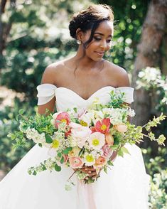 The Best Hairstyles for Every Wedding Dress Neckline | Martha Stewart Weddings - A subtle braid adds structure to an updo, while floating curls bring that softness Temur loves for this wedding dress style. #weddinghair #weddinginspiration #hairstyle #wedding #weddinghairdo