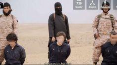 ISIS-Terroristen mit ihren Gefangenen. In der Mitte steht Jihadi John, ein britischer ISIS-Kämpfer, der mehrere westliche Geiseln, nun wohl auch den US-Amerikaner Peter Kassig ermordet hat