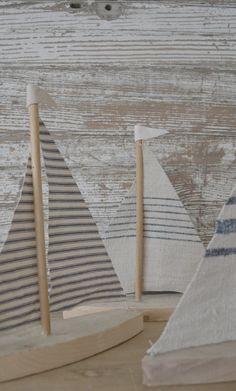 Little sailboats made out of 100 year old barn wood with scraps of  Vintage French Grain Sac fabric!