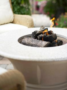Design Your Deck for a Fireside Chat.Give your deck the flickering warmth of a personal fire pit for cozy ambience as twilight approaches. Fire pits and firepots create an intimate setting at just a fraction of the size and cost of an outdoor fireplace. Outdoor Rooms, Outdoor Living, Fire Pots, Portable Fire Pits, Paved Patio, Fire Pit Area, Fire Pit Designs, Deck Decorating, Diy Fire Pit