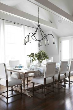 Maureen Griffin Ballsbaugh - Wonderful weathered wood trestle table with upholstered chairs that have darker wood.  Great contrast!